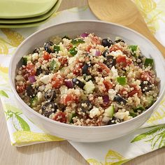 A side dish recipe with quinoa, fresh cucumber, seasoned tomatoes, olives and feta cheese