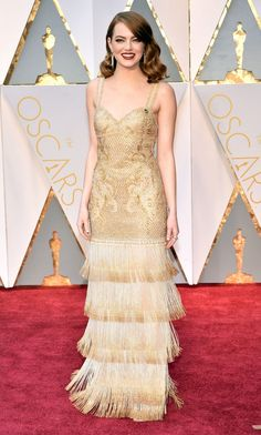 2017 Oscars: Emma Stone is wearing a gold Givenchy dress with intricate embroidery and fringe. I love the Old Hollywood Glamour look! Very 20s flapper! This is what an Oscar winner looks like!