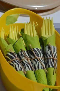 Use pieces of zebra print streamer for utensil wrap