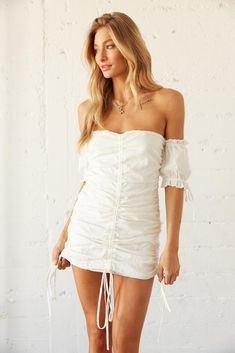 Hey babe, meet our Juniper Off Shoulder Cinched Mini Dress! This pretty piece features a ruched body, off the shoulder sleeves with tie details, and adjustable cinch ties throughout for the perfect fit. Available in white. Complete this dreamy look with the Yeoman Strappy Heel and you'll be set for your next elegant night! Ruched Dress, Tie Dress, Strapless Dress, Shoulder Sleeve, Off Shoulder Blouse, Off The Shoulder, Strappy Heels, Size Model, Perfect Fit
