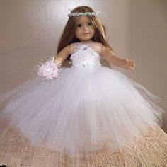 American Girl Doll Will Look Beautiful In This Dress. Made To Fit Any 18 Doll Similar To American Doll. Includes: Princess Ballgown Style Wedding Dress/Halo Headband and Bridal Bouquet Dress Has Waffle Stretch Top,Long Tulle/Tutu Style Skirt. Adorned At Waist With White Silk Flowers and Organza Ribbons.Rhinestone At Neck. Ribbon Ties Around Neck. Headpiece Has Pearls,Ribbons,Tulle Silk Flower. Brides Bouquet Made With Pink/White Silk Flowers and Ribbon. We Will Be Adding Se...