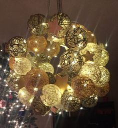 Twinkling Yarn Ball Wreath.  ( change up with different colored threads/cording )  I like this alot!!