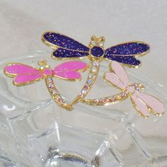 This #vintage pink purple rhinestone three dragonfly brooch is just beautiful!  It features a gold tone trio of dragonflies with hot pink, pale pink and purple glittery enam... #etsy #christmas #antique #shopping ➡️ http://jto.li/Jjq79
