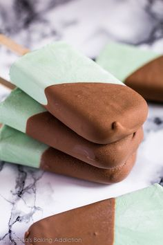 Deliciously creamy mint popsicles studded with chocolate chips and dipped in a milk chocolate magic shell. Perfect for hot summer days!