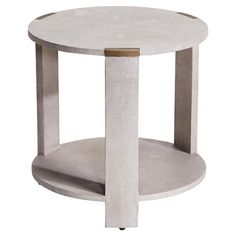 Contemporary and sophisticated, this end table is the perfect accent piece if you want to add some character to your space. The clean silhouette is wrapped in cream faux shagreen, a dimensional finish that draws the eye in.  Brass accents add an industrial touch and help define the shape of the tabletop.