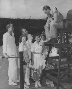 """Douglas Fairbanks, Jr. chats with Lester Stoefen and Bill Tilden and actresses Paulette Godard and Judy Garland. """"Big Bill"""" Tilden dominated tennis during the 20s, becoming the first American male to win Wimbledon. While the conservative mores of the times demanded that Tilden hide his homosexuality, he is remembered today as one of sports' elite gay athletes"""