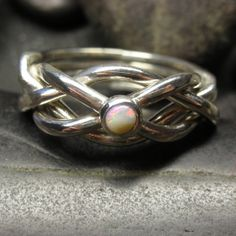 Opal puzzle ring in sterling silver Handmade to by nellyvansee
