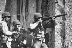 Infantry Division soldiers take aim at a sniper near Cisterna, Italy, during the 1944 Battle of Anzio. (George Silk/Life Magazine/The Life Picture Collection/Getty Images) Military Photos, Military History, Ww2 History, Military Art, Ww2 Pictures, Army Infantry, Prisoners Of War, American Soldiers, German Army