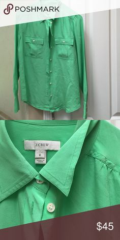 JCrew 100% silk blouse. Size 0. Jcrew bright green button down blouse. Goes perfect with my tweed skirt which I have listed. Great condition! A few spots under the collar, but hardly noticeable. Perfect top for spring and summer. J. Crew Tops Button Down Shirts