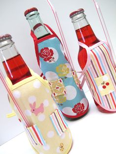 Apron Bottle Covers Sewing Tutorial - super cute little addition to gifting a bottle of homemade vanilla or anything else.