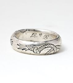 Tying the knot? This ring is hilariously awesome in it's Amelia Bedilia style literalism - and also totally beautiful. This ring is perfect for the man who wants some quiet, subtle razzle-dazzle in his wedding bands: traditional silhouette, unexpected rope etching.