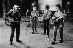 The Traveling Wilburys - Bob Dylan, Tom Petty, Jeff Lynne and George Harrison.