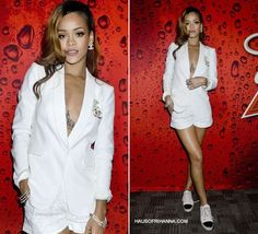 Rihanna in Rag and Bone white Jefferson blazer, ALC white shorts, Chanel jewelry and Chanel cap toe sneakers