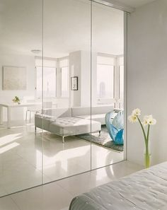 MIRRORS. WHY: The mirrors make the room like a lot larger and it makes the room look more open and fresh. DEF: often used to cover one wall in a room for accent and can make a small room appear large.