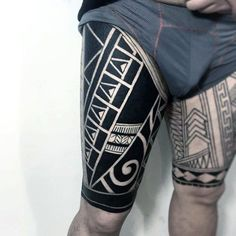 Man With Maori Tattoos On Upper Leg Thighs