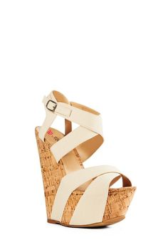 For a spring bridal shower, wear this sky-high wedge with your dress or skirt.