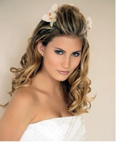 my wedding hair style.....thick hair, round face, volume, but not too much.  elegant but sexy.