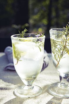 Gin and rosemary fizz: rosemary works so well with the juniper and other botanicals in gin. Keep the base syrup of rosemary and lemon in the fridge for up to two weeks, ready to make a cocktail with a twist at the drop of a hat. Recipes and food styling; Alice Hart, prop Styling; Lucy Attwater, photograph; Emma Lee. http://www.hglivingbeautifully.com/2015/05/06/a-summer-feast-in-the-forest/