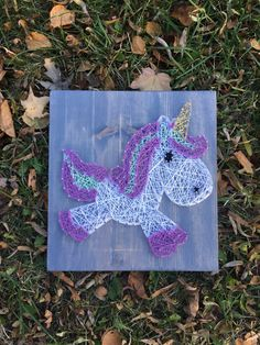 This magical creature is the PERFECT addition to any adorable room! This ready to hang string art sign is made of nails string and all the magical things!  Original design by James and The Letters