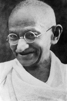 "A portrait of Mohandas ""Mahatma"" Gandhi. Second image: Gandhi during the Salt March."