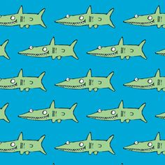 Nella - Blue Gift Wrap with Sharks A fantastic bright and colourful blue gift wrap from Nella with lots of hungry sharks