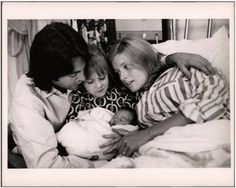 28th September 1969. A picture for the McCartney family album, Paul, Linda, Heather and baby Mary.