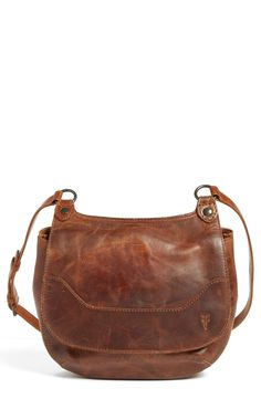 Obsessing over this stylish saddle bag from Frye that features a topstitched…