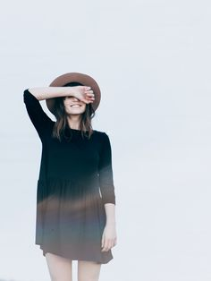 Simple black dress and hat.