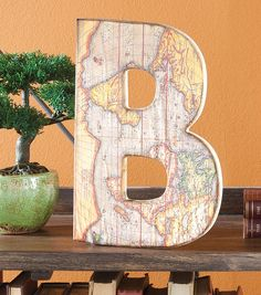 #DIY Decorative Letters | Decoupaged Map Letter | Office Decor Idea | Supplies available at Joann.com