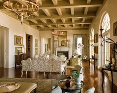 "For this ""Creole compound,"" architect Ken Tate combined elements that are typical of French Louisiana architecture with details that have a distinctly French West Indies-inspired look to reflect the home's waterfront setting just outside of New Orleans. With interiors designed by Ann Holden of Holden and Dupuy Interiors, the feel of the home is elegant but casual and embodies local traditions and culture."