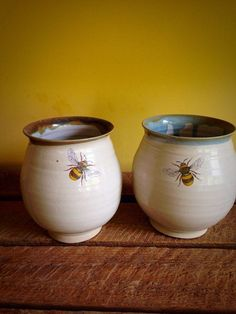 Two individually handmade ceramic stoneware pottery goblets with dainty bee design, because they are stoneware it keeps your wine colder for longer . Approx size 4 inches tall Any questions please dont hesitate to ask .