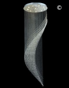 Modern Wave LED Chandelier- Width:80cm Height:260cm 10* LED's. Dressed in full lead Diamond Cut Crystal - Exclusive to Designer Chandelier Australia