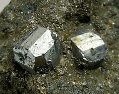 Cobaltite, CoAsS, crystals in pyrrhotite matrix, Hakansboda, Lindesberg, Västmanland  Sweden. Main crystal size: 0.5 × 0.5 cm. Copyright: © fabreminerals.com