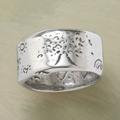 """SILVER STRENGTH RING--Jes MaHarry's hefty, 1/2""""-wide band of sterling silver is inscribed """"grow strong."""" Made in USA. Exclusive. Whole and half sizes 5 to 11-1/2."""