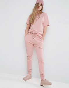 Buy it now. Criminal Damage Shoreditch Joggers - Pink. Sweatpants by Criminal Damage, Soft-touch sweat, Drawstring waistband, Side pockets, Fitted cuffs, Distressed holes to leg, Regular fit - true to size, Machine wash, 100% Cotton, Our model wears a UK S/EU S/US S and is 174cm/5'8.5 tall. ABOUT CRIMINAL DAMAGE East London label Criminal Damage put their unique stamp on streetwear and give it a trend-led edge. Slogan print t-shirts and sweats span the dark and macabre to the bright and bold…
