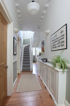 hallway flooring Wooden flooring and door, white skirting and stairs, super large radiator cover Hallway Colours, House, Wooden Flooring, Home, Victorian Hallway, Hallway Flooring, Hallway Lighting, Large Radiator Covers, Hallway Designs