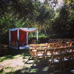 An unique semi circle formation of chairs for a Hindu blessing of marriage at Orcutt Ranch in West Hills. The beautiful structure was handmade and designed by the groom's father.