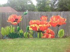 Beautiful flower mural painted on a fence. I would love this in my backyard.