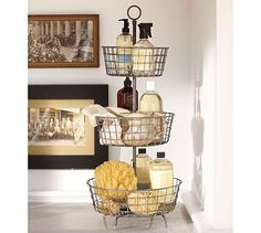 Tiered baskets keep bathroom necessities off te counter and easily moved for cleaning. I think I saw something like this at #HobbyLobby.