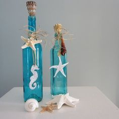 beach house decorations decorations- try my own with old wine bottles. paint insides shades of blue and green, cut sea shape from paper, glue to front of glass, spray bottle with etching paint, remove paper. shape stays darker color on frosted sea-glass looking bottle.
