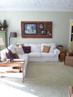 Using stained boards above the couch to hang pictures and other decor. Less nail holes in the wall and a lot more character!