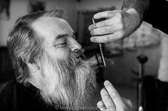 Fast flying scissors trimming Lance's beard in double time