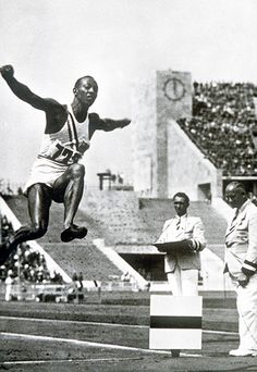 Berlin Olympics, 1936 : 'Jesse' Owens' next event was the long jump but he was in danger of going out in the qualifying session after recording two no jumps. It was only the assistance of Germany's Luz Long, who suggested he set his runup maker a foot or so further back, that meant that Owens' next jump was good and he sailed into the final. In the penultimate round Luz was leading on 7.87m until Owens put in two mighty jumps of 7.94m and 8.06m to take gold