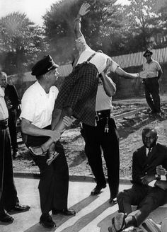 Elizabeth Victoria Spencer is carried away by police during a protest against segregation, August 7, 1963.