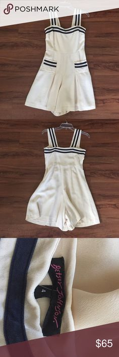 Vintage Betsey Johnson sailor nautical Romper sz 4 Vintage Betsey Johnson sailor/nautical romper in size 4. its an ever so slight off white straps are button on so the can be shortened or criss crosss if need be. there is a side zipper on the right abd two tiny functional pockets (probably would only fit a lipstick and or maybe house key ) in good used condition slight under arm discoloration but hardley noticable. Betsey Johnson Pants Jumpsuits & Rompers