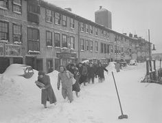 Workers struggling through the snow on one of Boston's wharves.
