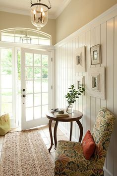 pretty entryway decoration with chair and table