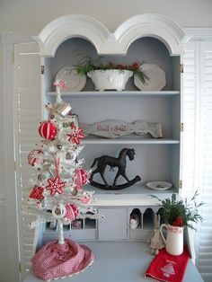 Swedish decor, love the red & white theme, & aside from Christmas, the shape of the top of the shelf!