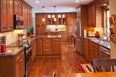 Designed by our talented friends in Minnesota, this space features our Covington door in cherry Autumn! Sending our thanks to The Cabinet Store! Beautiful design!  Learn more about The Cabinet Store: http://www.thecabinetstore.com/ Learn more about Showplace cherry: http://www.showplacewood.com/WoodsFin2/woodsC.0.html