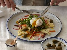 Poached eggs top this sweet and sour spring salad.